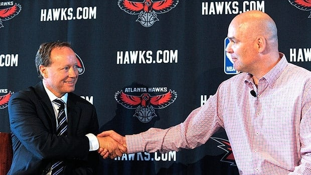 Atlanta Hawks President of Basketball Operations and General Manager Danny Ferry, right, shakes hands with his new head coach, Mike Budenholzer.