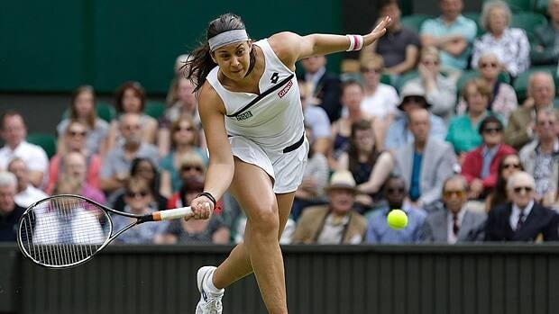 Marion Bartoli of France plays a return to Kirsten Flipkens of Belgium in semifinal action on Thursday.