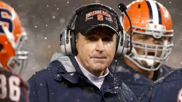 Head coach Doug Marrone of the Syracuse Orange works on the sidelines against the West Virginia Mountaineers in the New Era Pinstripe Bowl at Yankee Stadium on Dec. 29, 2012.