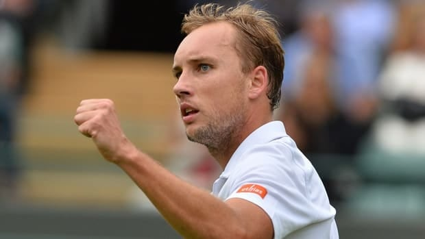Steve Darcis celebrates a point during the massive upset Monday at Wimbledon.