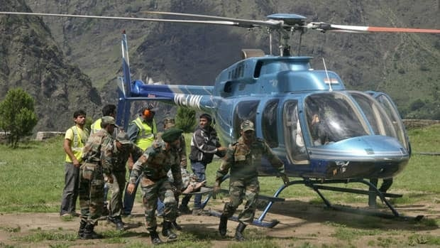 Protesters complained that the government was taking too long to evacuate some areas, with small helicopters bringing in four to five people at a time.