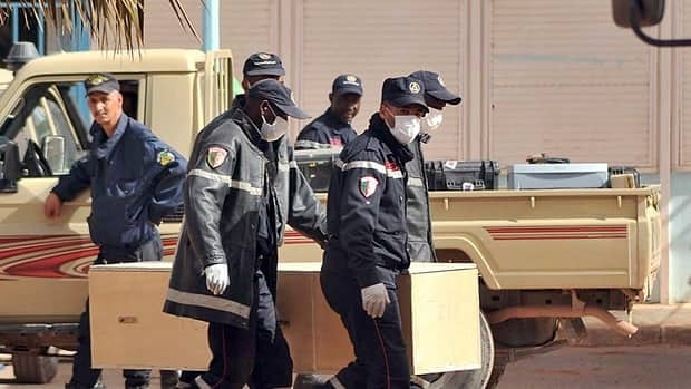 "Algerian firemen carry a coffin containing a person killed during the gas facility hostage situation at the morgue in Ain Amenas, Algeria last Monday. The Algerian government says two of the hostage-takers were Canadian, but Prime Minister Stephen Harper says Canada doesn't have ""substantial information at the present time on these particular individuals."""