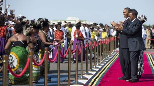 U.S. President Barack Obama, left, and Tanzanian President Jakaya Kikwete applaud a group of performers during an arrival ceremony at Julius Nyerere International Airport in Dar Es Salaam on Monday. Obama was in Tanzania on the final leg of his three-country tour in Africa.