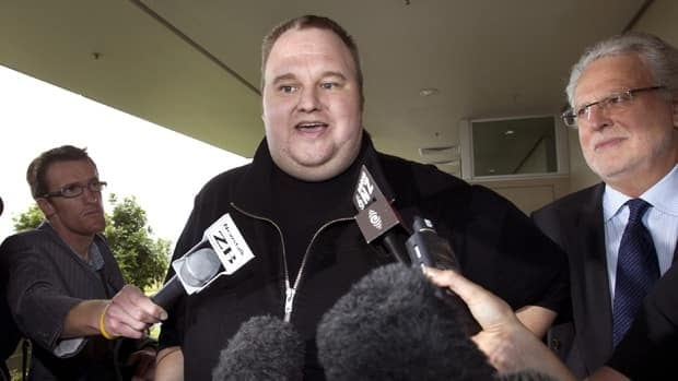 Kim Dotcom, the founder of the file-sharing website Megaupload, comments after he was granted bail and released in Auckland, New Zealand, in March 2012. In interviews with media, he said the charges against him were politically motivated. (Brett Phibbs/New Zealand Herald/AP)