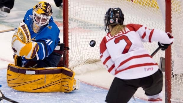 Team Canada's Meghan Agosta-Marciano and Team Finalnd goalie Noora Raty watch the puck enter the net on a shot from Canada's Sarah Vaillancourt, not shown, during the third period Friday at the women's world hockey championships in Ottawa.
