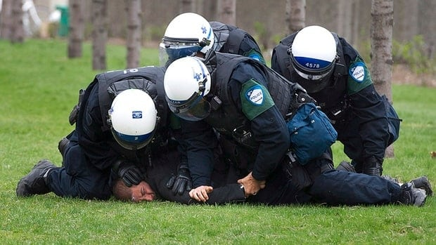 A protester being arrested at an anti-tuition hike demonstration last April.