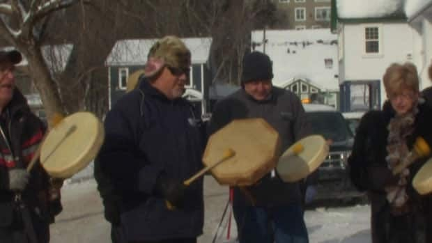 Qalipu members and supporters drum on Church Street in Corner Brook on Monday.