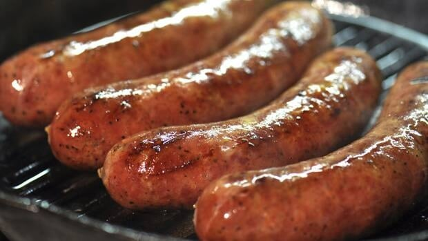 Provincial police in Parry Sound say they charged two men after another was hit in the face and had his package of wild game sausages stolen.
