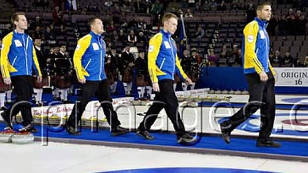 Team Alberta from left, Karrick Martin, Ben Hebert, Marc Kennedy, John Morris and Kevin Martin take part in the opening ceremonies at the Tim Hortons Brier in Edmonton, Alta., on Saturday afternoon.