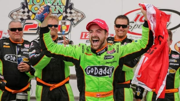 James Hinchcliffe, centre, celebrates as he gets out of his car after winning the IndyCar series auto race in Newton, Iowa on Sunday.
