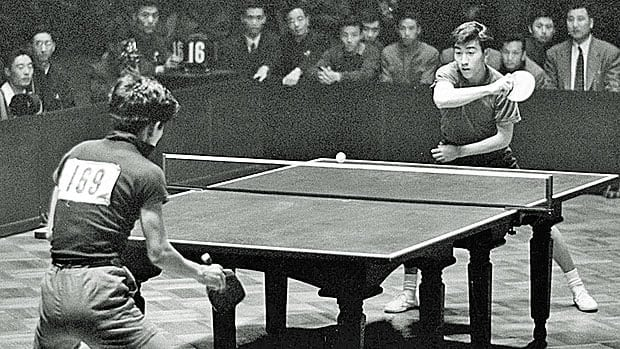 Zhuang Zedong, right, competes in the men's team finals of the 26th World Table Tennis Championship in Beijing in April 1961, his first world championship.
