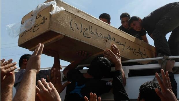 A funeral was held Saturday for a man killed in a bomb attack in Najaf, south of Baghdad, on Friday. Bomb blasts in the Iraqi capital killed at least 20 more people on Friday at the end of a week of bloodshed that prompted a UN envoy to warn Iraq was 'at a crossroads.'