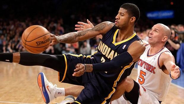 Paul George of the Indiana Pacers, left, battles with New York Knicks veteran Jason Kidd during a late regular season game.