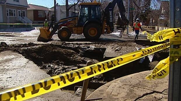 Crews repair a watermain break near 111th Avenue and 96th Street in north Edmonton Tuesday.