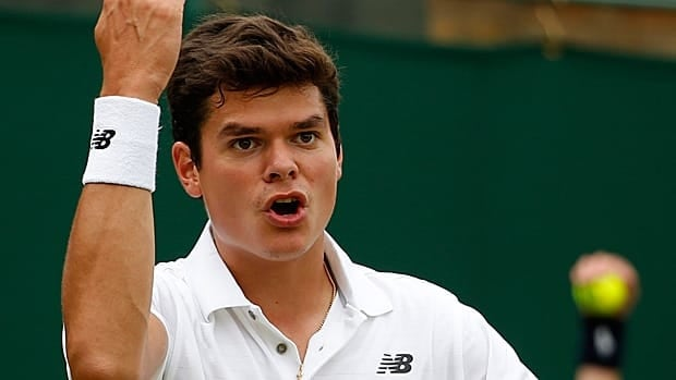 Milos Raonic of Canada reacts to a line call during his match against Igor Sijsling of the Netherlands their second round singles match at All England Club.