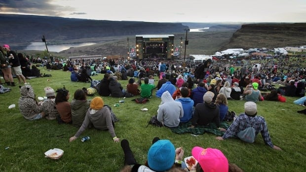 "Concertgoers watch the stage at the Gorge Amphitheater in Eastern Washington in this May 2013 photo. Authorities say one man died and dozens of people were sickened after taking a drug called ""Molly"" this past weekend at a music festival at the Gorge."