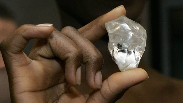 A monitoring group on conflict diamonds is condemning Belgium's Valentine's Day call to ease controls on diamonds from eastern Zimbabwe.