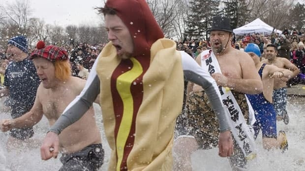 Over 500 people ran into Lake Ontario's icy waters Tuesday during the New Year's Day polar bear dip in Oakville, Ont., according to organizers.