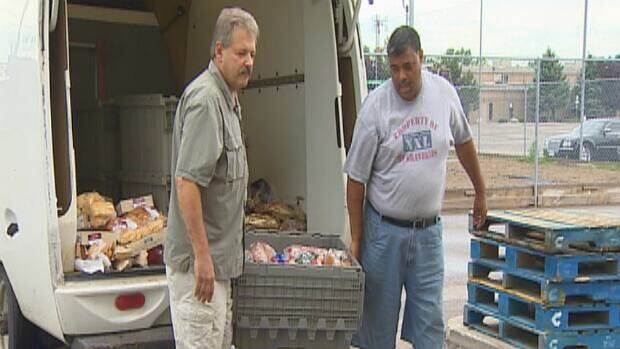 Members of Windsor Lifeline Outreach gather food donations for Alberta flood victims Tuesday.