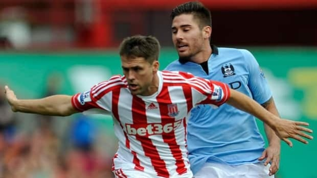 Stoke City striker Michael Owen, left, confirmed Tuesday that he will retire at season's end.