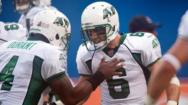 Rob Bagg, right, is congratulated by teammate Darian Durant in Saskatchewan's 39-28 win.