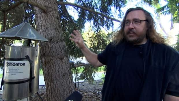City of Edmonton mosquito expert Mike Jenkins, seen here with one of the city's light traps, says this has been an odd season for mosquito control.