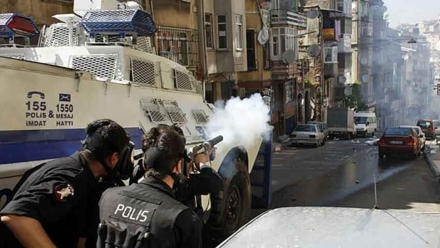 Riot police fire tear gas at Turkish protesters in Istanbul in mid-May. Tear-gas confrontations resumed Friday, as people responded to tighter controls over alcohol and public displays of affection.