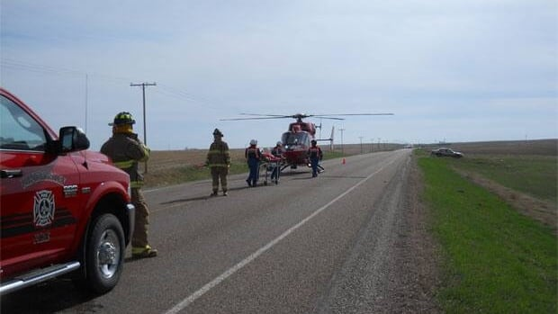 Man, 52, being loaded into an airambulance on Highway near Kindersley after he was injured in a motorcycle crash.