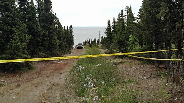 Police tape marks a road in Sheshatshiu, where the RCMP are investigating a sudden death.