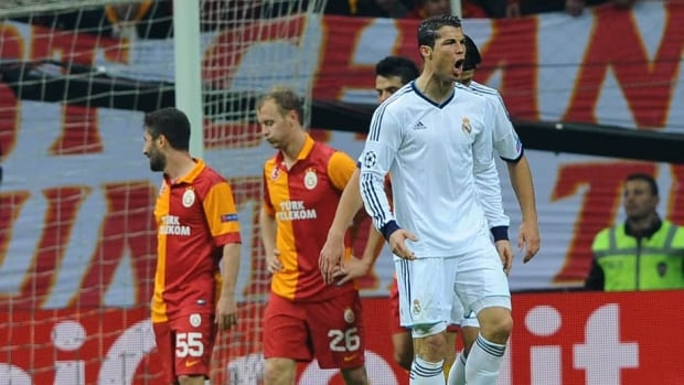Real Madrid's Cristiano Ronaldo, right, celebrates after scoring his second goal during the UEFA Champions League quarter-final second leg on Tuesday at Ali Sami Yen stadium in Istanbul.