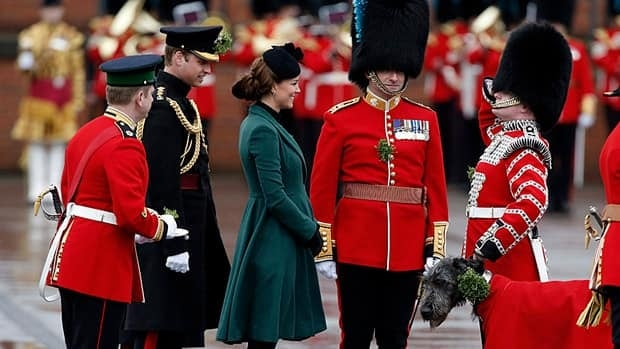 The pregnant Duchess of Cambridge, centre, flanked by her husband Prince William, receives a salute after presenting a traditional sprig of shamrock to the 1st Battalion Irish Guards on St. Patrick's Day. Canada's bill to agree to changes in the royal line of succession is set for third reading in the Senate as early as this week.