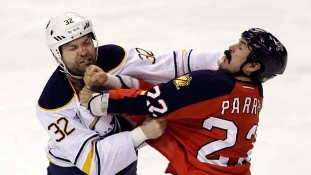 John Scott, left, and George Parros of Florida scrap during a game in February in Buffalo.