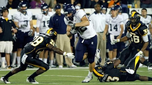 Rice tight end Luke Willson powers past Southern Mississippi defence on Oct. 1, 2011.