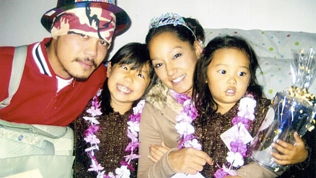 Phonesay Chanthachack, left, is shown with partner Natasha Thompson and daughters Hana and Miyoko. The 27-year-old was shot and killed during a confrontation with Hamilton police last year.