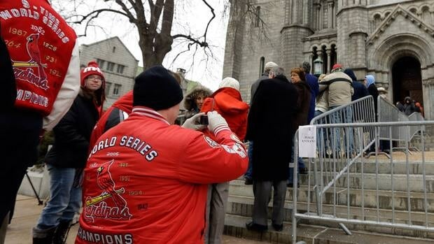 People outside Cathedral Basilica of Saint Louis waiting to pay their respects during the public visitation.