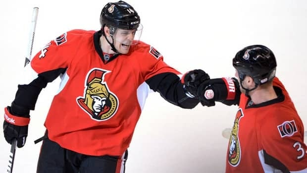 Ottawa Senators forward Colin Greening, left, celebrates his game-winning goal against the Toronto Maple Leafs with teammate Marc Methot Saturday night.