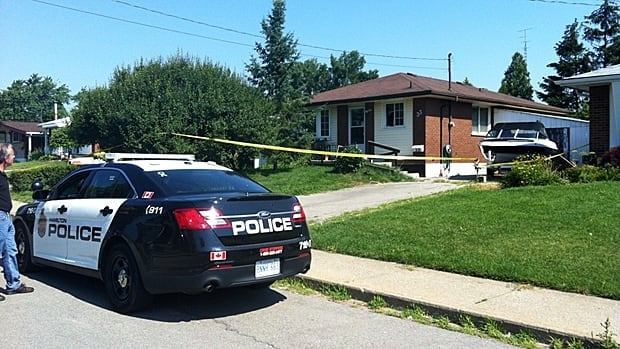 Police tape covers a Lilacside Drive home after a pair of late-night break and enters, including one involving an 86-year-old woman. The suspect died in hospital.
