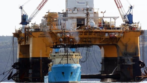 The drill rig Henry Goodrich is shown under tow by one of two supply vessels near Bell Island in 2012.
