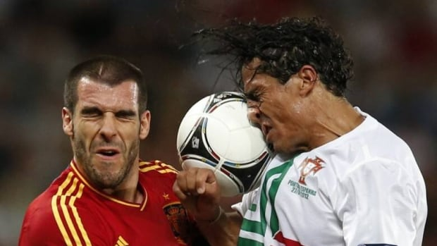 Spain's Alvaro Negredo and Portugal's Bruno Alves, right, jump for a header during their Euro 2012 semi-final soccer match in Donetsk, Ukraine, on June 27. (Juan Medina/Reuters)