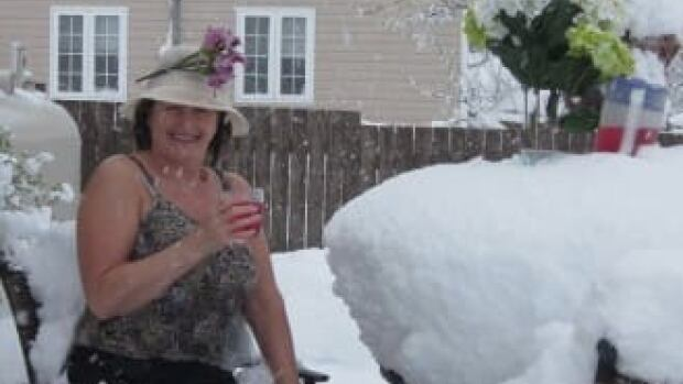 In this CBC file photo from May 24th weekend in 2013, Clarice Sheppard says snow is simply a Newfoundlander's remedy for hot flashes.