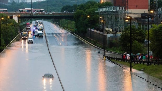 Water from the Don River covers the entire DVP after a flood last year. The city plans to study a number of solutions, including raising the DVP, to help with flooding. (Mark Blinch/Reuters)