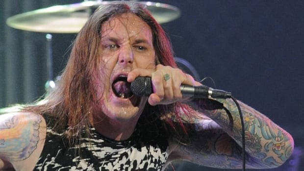 Tim Lambesis, lead singer of heavy metal band As I Lay Dying, performs in April 2010 at the second annual Revolver Golden Gods Awards in Los Angeles.