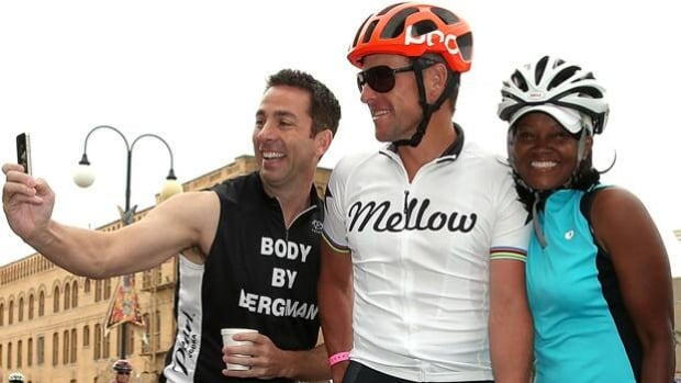 Lance Armstrong, middle, is being ordered to testify in a lawsuit to recover bonuses paid him.