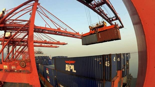 A crane loads containers at a port in Lianyungang, Jiangsu province, on Thursday.