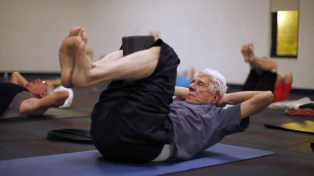 Retirees participate in a yoga class in Sun City, Arizona. A French study found that people who retired later seemed to have less dementia.