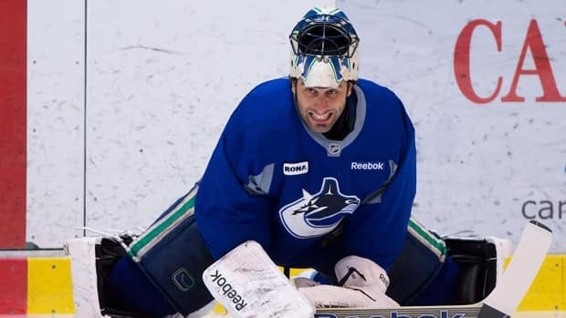 Vancouver Canucks' Roberto Luongo stretches before an informal hockey practice at the University of British Columbia in Vancouver, B.C., on Friday January 11, 2013.
