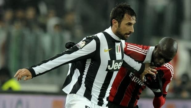 Mirko Vucinic of Juventus, left, scored the winning goal in extra time against AC Milan on Wednesday in Turin, Italy.