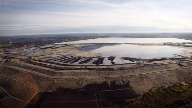 An aerial view of an oilsands tailings pond near Fort McMurray, Alta. Tailings are proving trickier to clean up than energy companies and regulators thought they would be.