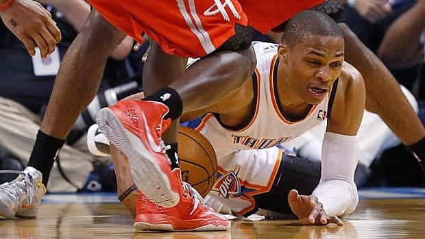 Oklahoma City Thunder guard Russell Westbrook goes down in Game 2 between former teammate James Harden and Patrick Beverly of Houston.