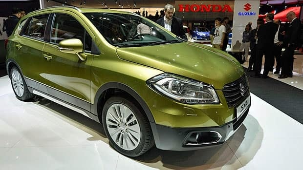 Cars like the Suzuki SX4 S-Cross, shown at the 83rd Geneva International Motor Show in Geneva, Switzerland, won't be sold in Canada in 2014.